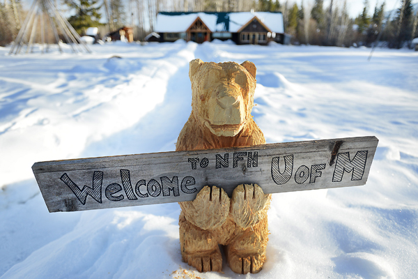 A sign outside the North Fork Hostel welcomes students from the University of Montana for the one week exploration of the Polebridge region on Monday, January 21. (Brenda Ahearn/Daily Inter Lake)